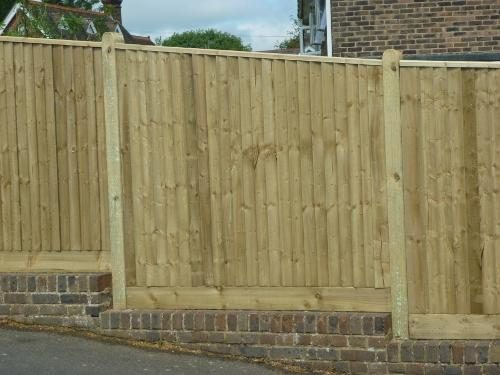 Closeboard fence on a wall