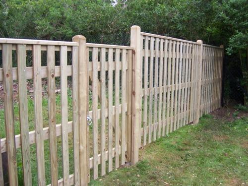 Palisade with capping and a matching gate.