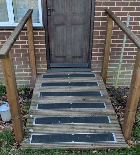 York decking used to make a access ramp with handrails. Fitted with 1m x 115mm anti-slip plates supplied by Crestala fencing.