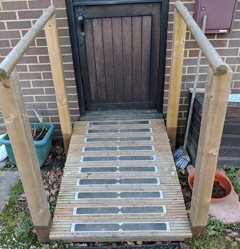 York decking used to make a access ramp with handrails. Fitted with 635mm x 62mmmm anti-slip plates supplied by Crestala fencing.