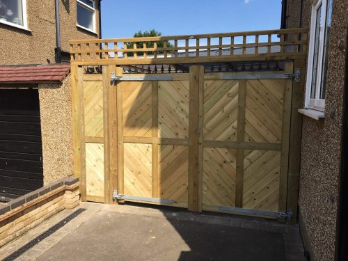 A pair of bespoke gates with a matching infill panel, made by Crestala for VZ Security